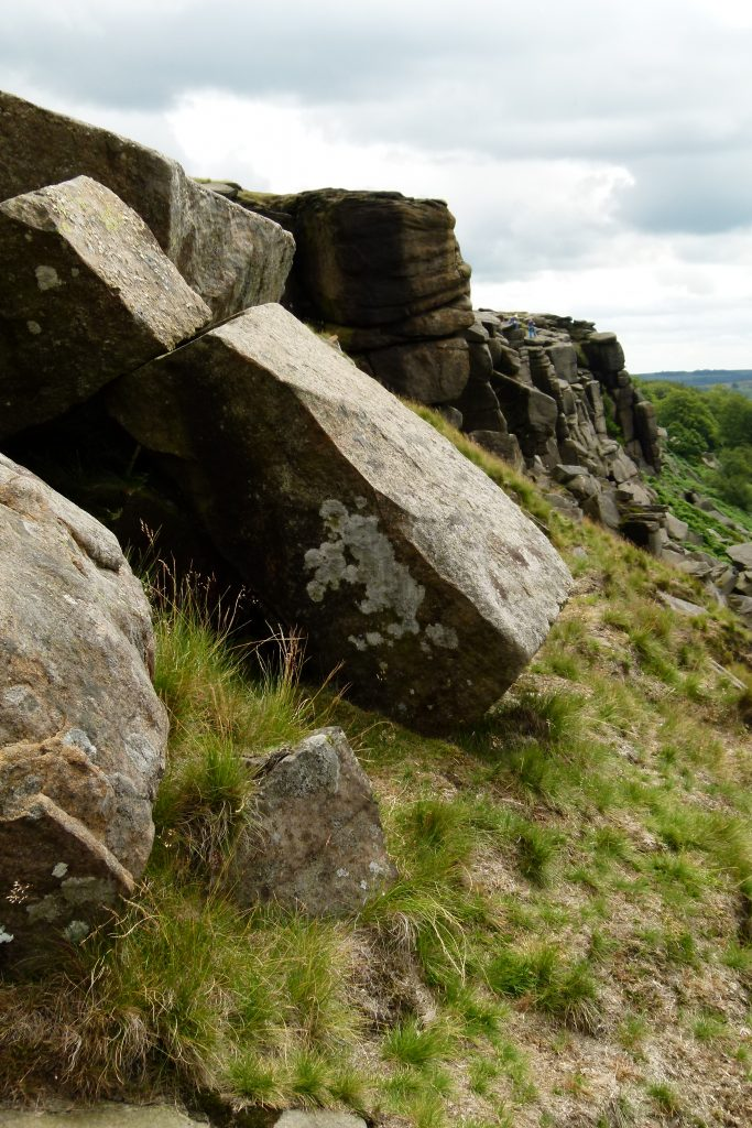 Photo of a square boulder leaning on another on Stanage Edge.