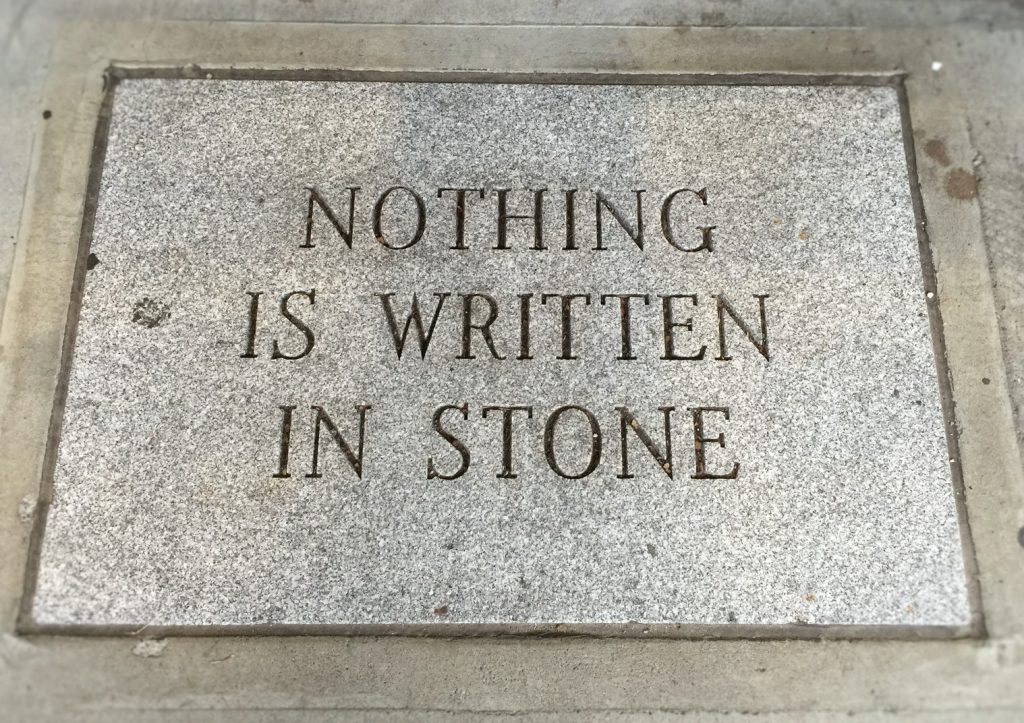 """A sign, written in stone, saying """"Nothing is written in stone"""""""